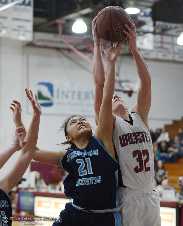 . Chico State\'s #32 Michelle Walker (right) rebounds against Sonoma State\'s #21 Famh Fong (left) in the second half of their women\'s basketball game at CSUC Acker Gym Friday January 31, 2014 in Chico, Calif. (Jason Halley/Chico Enterprise-Record)
