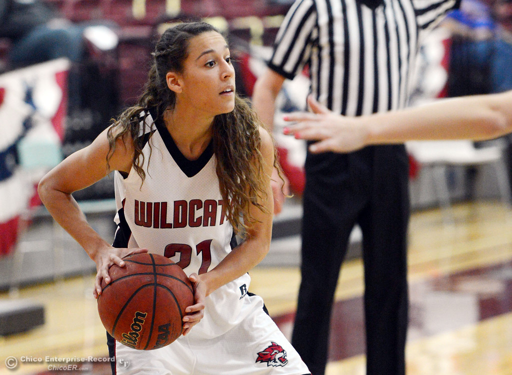 . Chico State\'s #21 Courtney Hamilton dribbles against Sonoma State in the second half of their women\'s basketball game at CSUC Acker Gym Friday January 31, 2014 in Chico, Calif. (Jason Halley/Chico Enterprise-Record)