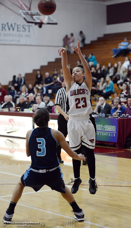 . Chico State\'s #23 Jazmine Miller (right) takes a shot against Sonoma State\'s #3 Taylor Acosta (left) in the second half of their women\'s basketball game at CSUC Acker Gym Friday January 31, 2014 in Chico, Calif. (Jason Halley/Chico Enterprise-Record)