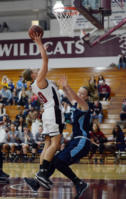 . Chico State\'s #40 Analise Riezebos (left) goes up for a shot against Sonoma State\'s #32 Hannah Sourek (right) in the second half of their women\'s basketball game at CSUC Acker Gym Friday January 31, 2014 in Chico, Calif. (Jason Halley/Chico Enterprise-Record)
