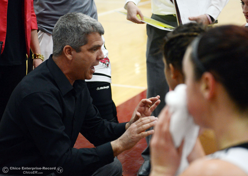 . Chico State head coach Brian Fogel (center) talks to the team in a timeout against Sonoma State in the second half of their women\'s basketball game at CSUC Acker Gym Friday January 31, 2014 in Chico, Calif. (Jason Halley/Chico Enterprise-Record)