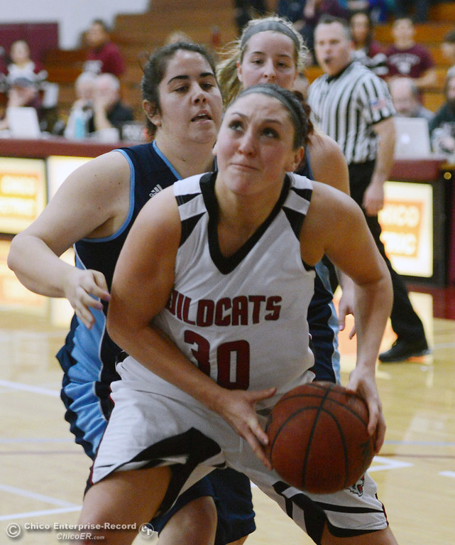 . Chico State\'s #30 McKenzie Dalthorp (right) goes up for a shot against Sonoma State\'s #34 Baylee Yates (left) in the second half of their women\'s basketball game at CSUC Acker Gym Friday January 31, 2014 in Chico, Calif. (Jason Halley/Chico Enterprise-Record)