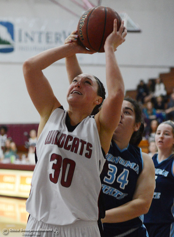 . Chico State\'s #30 McKenzie Dalthorp (left) is fouled as she goes up a shot against Sonoma State\'s #34 Baylee Tayes (right) in the second half of their women\'s basketball game at CSUC Acker Gym Friday January 31, 2014 in Chico, Calif. (Jason Halley/Chico Enterprise-Record)