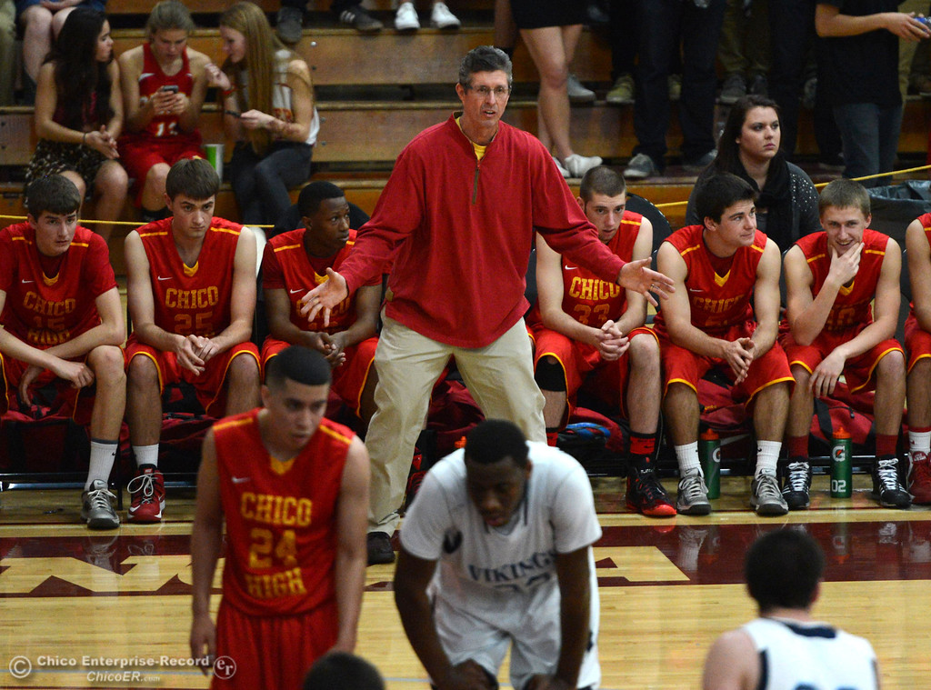 . Chico High coach Krik Bruchler looks on against Pleasant Valley High in the second quarter of their boys basketball game at Acker Gym Saturday, March 8, 2014 in Chico, Calif.  (Jason Halley - Enterprise-Record)