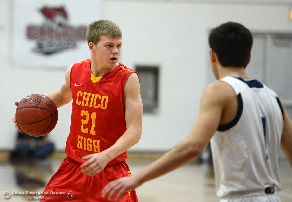 . Chico High\'s #21 Hunter Mootz dribbles against Pleasant Valley High in the fourth quarter of their boys basketball game at Acker Gym Saturday, March 8, 2014 in Chico, Calif.  (Jason Halley - Enterprise-Record)
