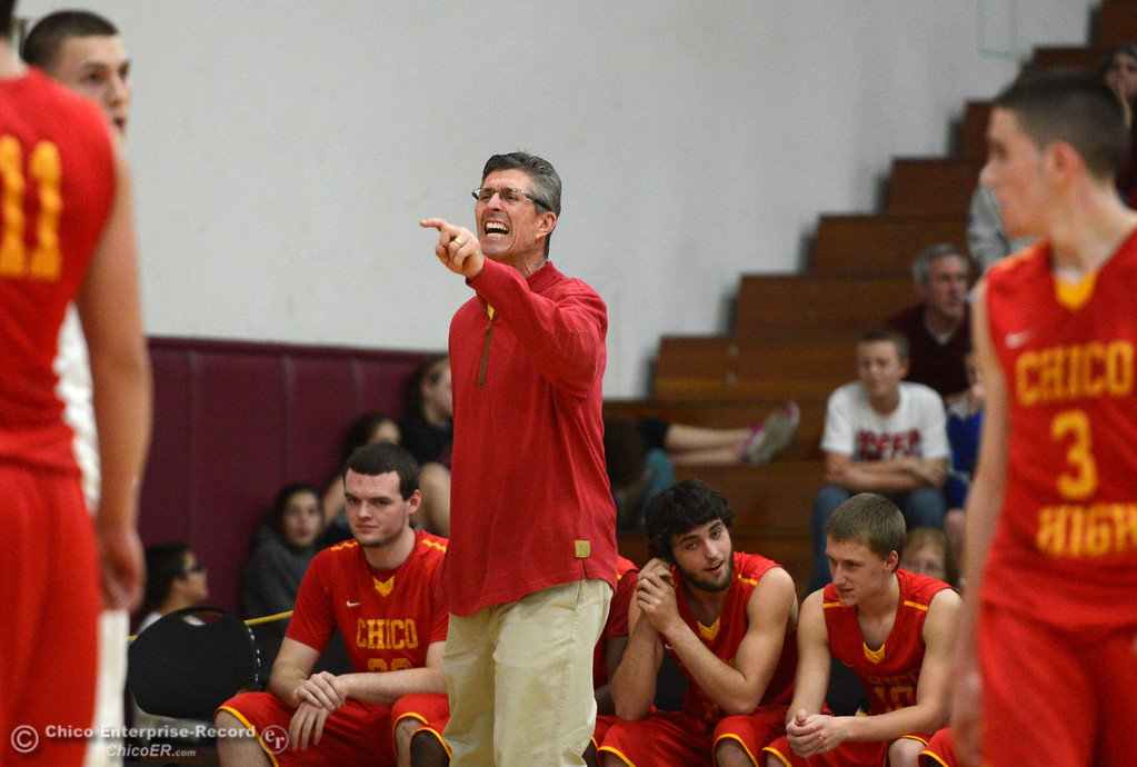. Chico High coach Kirk Bruchler makes the calls against Pleasant Valley High in the fourth quarter of their boys basketball game at Acker Gym Saturday, March 8, 2014 in Chico, Calif.  (Jason Halley - Enterprise-Record)