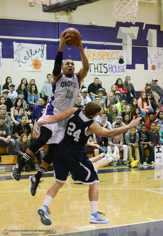 . Oroville High\'s #15 Derrek Gordon (top) goes up for a shot against Pleasant Valley High\'s #24 Zack Suttles (bottom) in the fourth quarter of their boys basketball game at OHS Wednesday, February 19, 2014 in Oroville, Calif.  (Jason Halley/Chico Enterprise-Record)