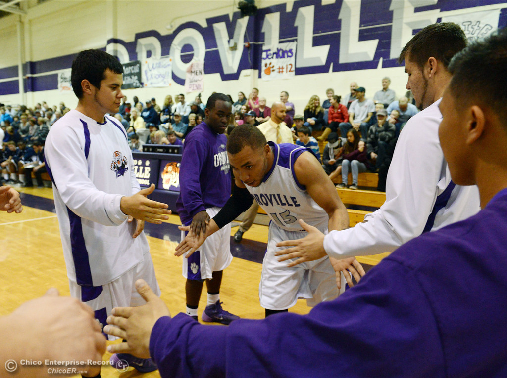 . Oroville High\'s #15 Derrek Gordon (center) comes on to the court against Pleasant Valley High in the first quarter of their boys basketball game at OHS Wednesday, February 19, 2014 in Oroville, Calif.  (Jason Halley/Chico Enterprise-Record)