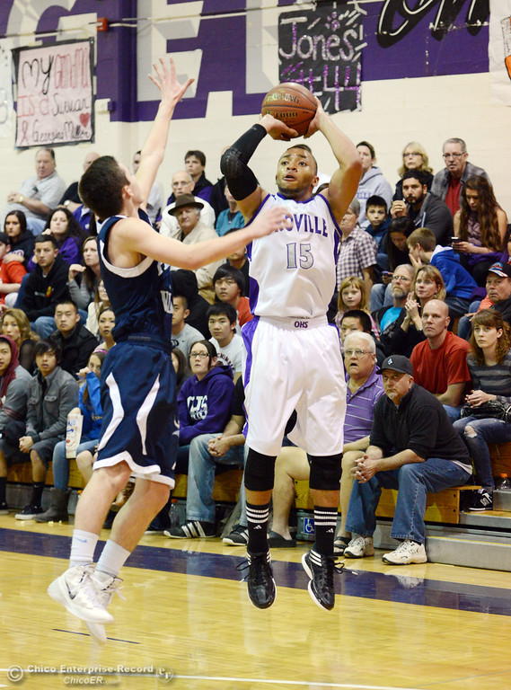 . Oroville High\'s #15 Derrek Gordon (right) takes a shot against Pleasant Valley High\'s #2 Matt Urrutia (left) in the second quarter of their boys basketball game at OHS Wednesday, February 19, 2014 in Oroville, Calif.  (Jason Halley/Chico Enterprise-Record)