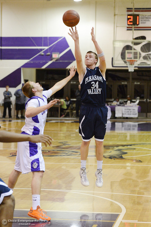 . Pleasant Valley High\'s #34 Brandt Hughes (right) takes a shot against Oroville High\'s #45 Eric Laster (left) in the first quarter of their boys basketball game at OHS Wednesday, February 19, 2014 in Oroville, Calif.  (Jason Halley/Chico Enterprise-Record)
