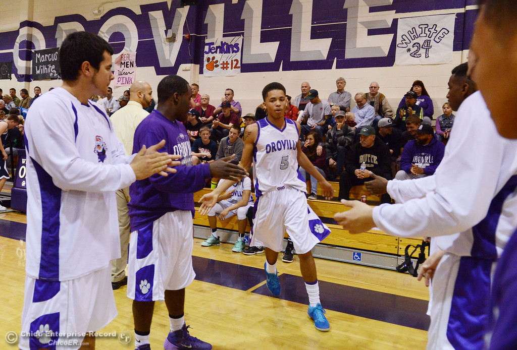 . Oroville High\'s #5 Kahliel Wyatt (center) comes onto the court against Pleasant Valley High in the first quarter of their boys basketball game at OHS Wednesday, February 19, 2014 in Oroville, Calif.  (Jason Halley/Chico Enterprise-Record)