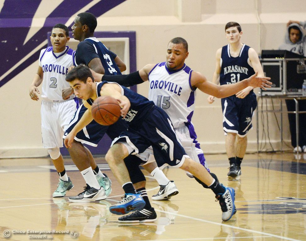 . Pleasant Valley High\'s #1 Joseph Abdulmasih (left) dribbles against Oroville High\'s #15 Derrek Gordon (right) in the second quarter of their boys basketball game at OHS Wednesday, February 19, 2014 in Oroville, Calif.  (Jason Halley/Chico Enterprise-Record)