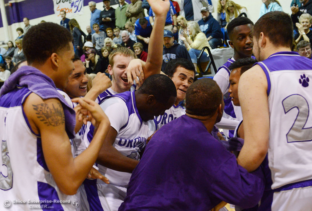 . Oroville High celebrate their win against Pleasant Valley High at the end of the fourth quarter of their boys basketball game at OHS Wednesday, February 19, 2014 in Oroville, Calif.  (Jason Halley/Chico Enterprise-Record)
