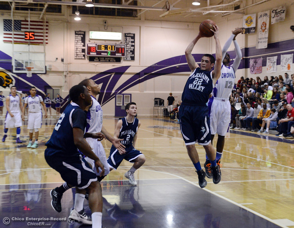 . Pleasant Valley High\'s #22 Tyler Schnerringer (left) rebounds against Oroville High\'s #12 Jabari Jenkins (right) in the second quarter of their boys basketball game at OHS Wednesday, February 19, 2014 in Oroville, Calif.  (Jason Halley/Chico Enterprise-Record)