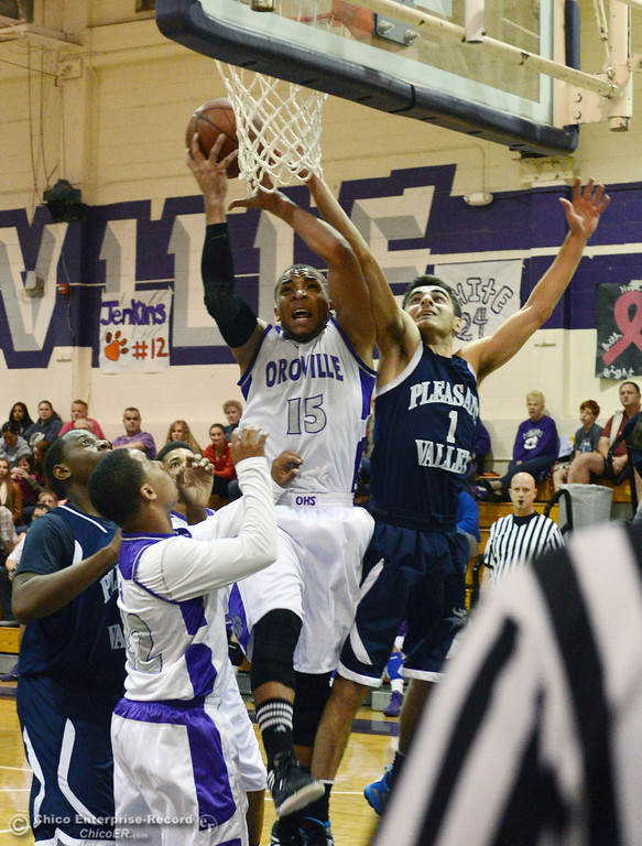 . Pleasant Valley High\'s #1 Joseph Abdulmasih (right) attempts to rebound against Oroville High\'s #15 Derrek Gordon (left) in the first quarter of their boys basketball game at OHS Wednesday, February 19, 2014 in Oroville, Calif.  (Jason Halley/Chico Enterprise-Record)
