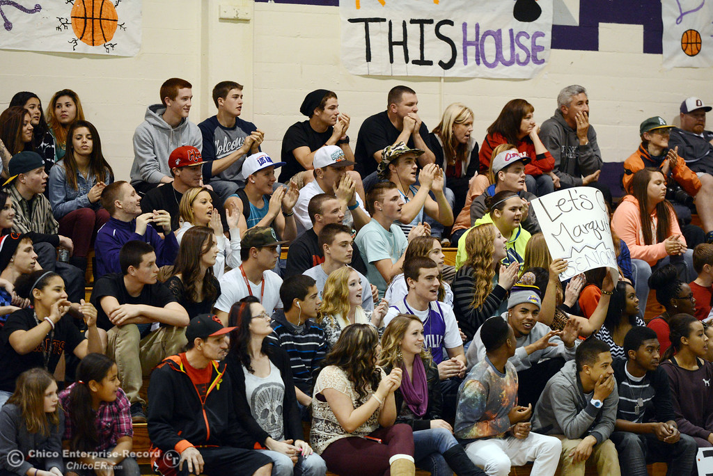 . Oroville High fans cheer on against Pleasant Valley High in the fourth quarter of their boys basketball game at OHS Wednesday, February 19, 2014 in Oroville, Calif.  (Jason Halley/Chico Enterprise-Record)