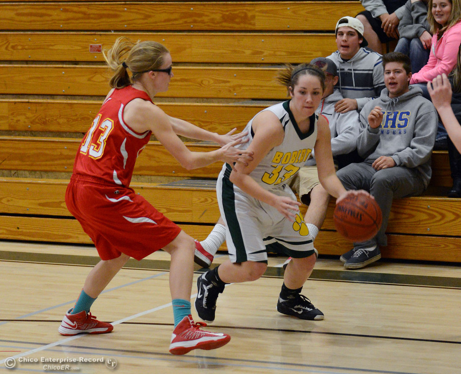. Chico High\'s #13 Sharlotte Sheffield (left) defends against Paradise High\'s #33 Mariah Mundt (right) in the second quarter of their girls basketball game at PHS Tuesday, February 18, 2014 in Paradise, Calif.  (Jason Halley/Chico Enterprise-Record)