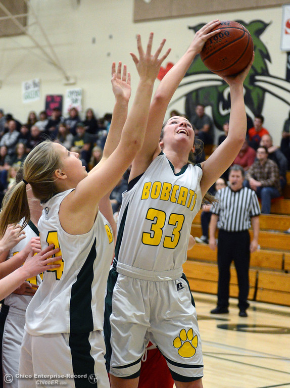 . Paradise High\'s #33 Mariah Mundt (right) rebounds against Chico High in the second quarter of their girls basketball game at PHS Tuesday, February 18, 2014 in Paradise, Calif.  (Jason Halley/Chico Enterprise-Record)