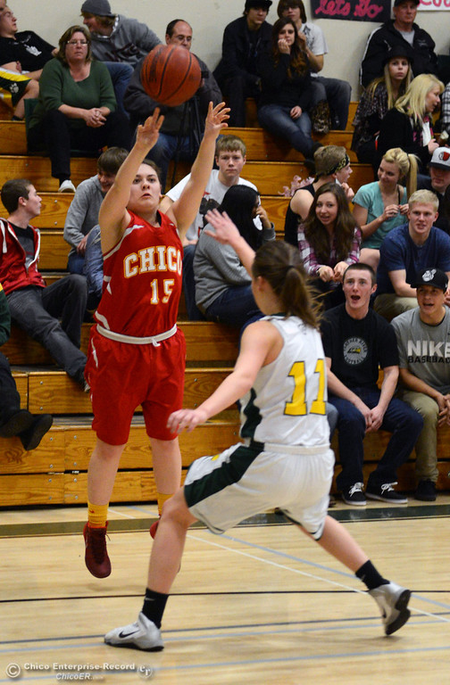 . Chico High\'s #15 Tiffany Kelly (left) takes a shot against Paradise High\'s #11 Cassidy Burnett (right) in the first quarter of their girls basketball game at PHS Tuesday, February 18, 2014 in Paradise, Calif.  (Jason Halley/Chico Enterprise-Record)