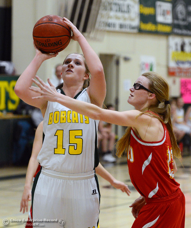 . Paradise High\'s #15 Bailey Bengson (center) takes a shot against Chico High\'s #13 Sharlotte Sheffield (right) in the second quarter of their girls basketball game at PHS Tuesday, February 18, 2014 in Paradise, Calif.  (Jason Halley/Chico Enterprise-Record)