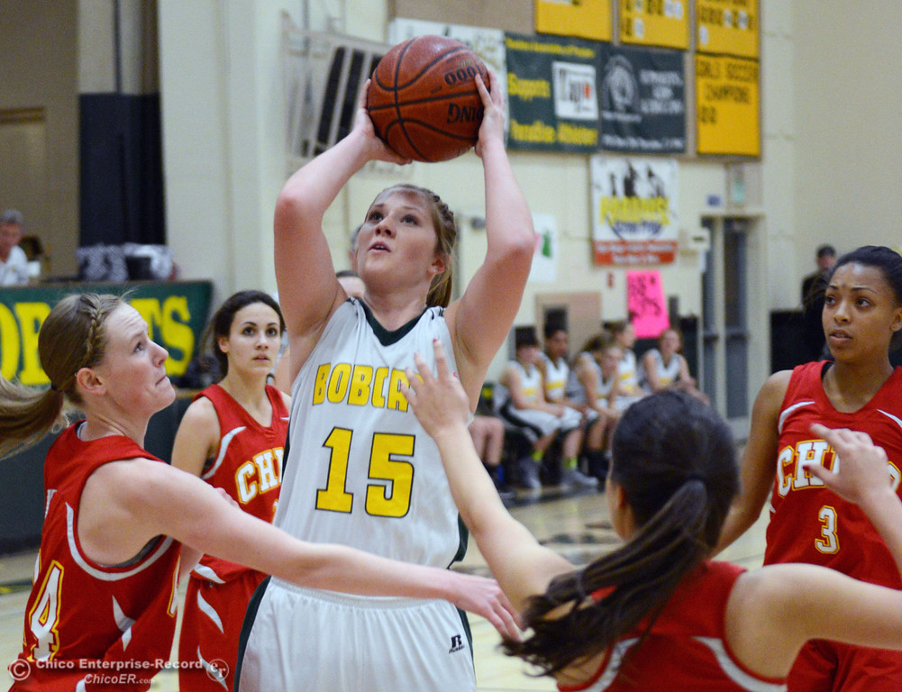. Paradise High\'s #15 Bailey Bengson (right) takes a shot against Chico High\'s #14 Lindsey Lundberg, #22 Cia Seibert, #5 Sarah Seibert, and #3 Myki Abrams (left to right) in the second quarter of their girls basketball game at PHS Tuesday, February 18, 2014 in Paradise, Calif.  (Jason Halley/Chico Enterprise-Record)