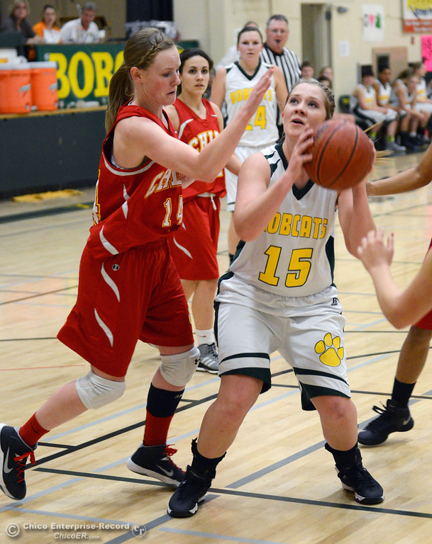 . Paradise High\'s #15 Bailey Bengson (right) takes a shot against Chico High\'s #14 Lindsey Lundberg (left) in the second quarter of their girls basketball game at PHS Tuesday, February 18, 2014 in Paradise, Calif.  (Jason Halley/Chico Enterprise-Record)