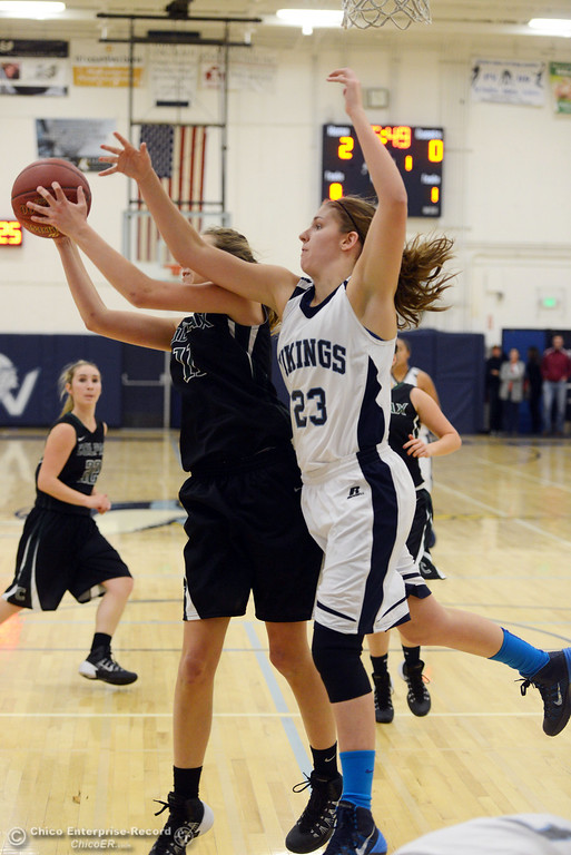 . Pleasant Valley High\'s #23 McKena Barker (right) attempts to rebound against Colfax High\'s #11 Kylee Bauer (left)  in the first quarter of their girls basketball game at PV\'s Varley Gym Saturday, December 7, 2013 in Chico, Calif. (Jason Halley/Chico Enterprise-Record)