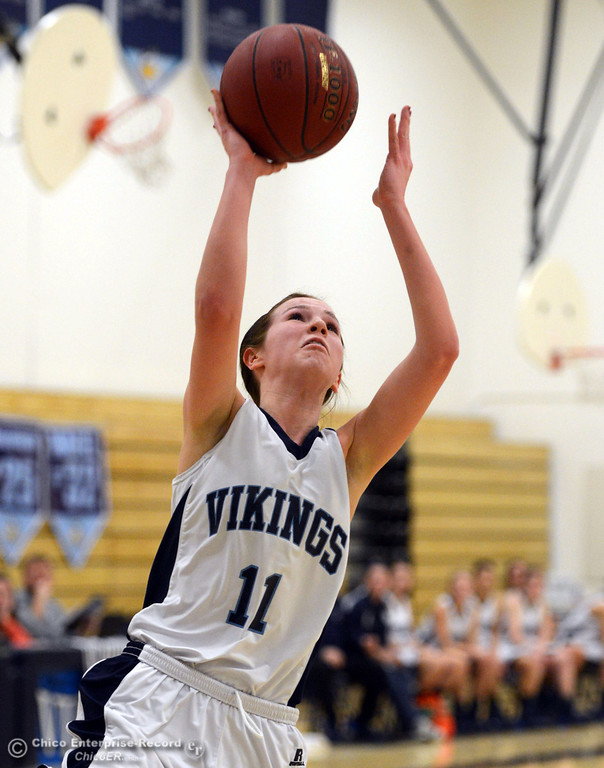 . Pleasant Valley High\'s #11 Kristina Joyce goes up for a shot against Colfax High in the first quarter of their girls basketball game at PV\'s Varley Gym Saturday, December 7, 2013 in Chico, Calif. (Jason Halley/Chico Enterprise-Record)