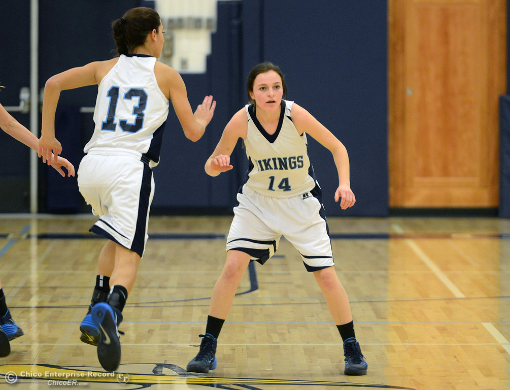 . Pleasant Valley High\'s #14 Kayla Joyce defends against Colfax High in the first quarter of their girls basketball game at PV\'s Varley Gym Saturday, December 7, 2013 in Chico, Calif. (Jason Halley/Chico Enterprise-Record)