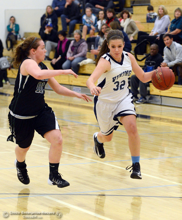 . Pleasant Valley High\'s #32 Natalie Makel (right) dribbles against Colfax High\'s #10 Taylor Avila (left) in the first quarter of their girls basketball game at PV\'s Varley Gym Saturday, December 7, 2013 in Chico, Calif. (Jason Halley/Chico Enterprise-Record)