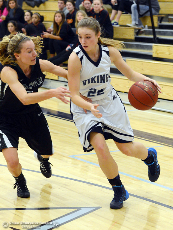 . Pleasant Valley High\'s #22 Ashley Geiger (right) dribbles against Colfax High\'s #3 Kyra Heimann (left) in the second quarter of their girls basketball game at PV\'s Varley Gym Saturday, December 7, 2013 in Chico, Calif. (Jason Halley/Chico Enterprise-Record)