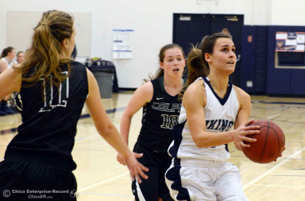 . Pleasant Valley High\'s #3 Izzy Bonacorsi (right) dribbles against Colfax High\'s #10 Taylor Avila (center) and #11 Kylee Bauer (left) in the first quarter of their girls basketball game at PV\'s Varley Gym Saturday, December 7, 2013 in Chico, Calif. (Jason Halley/Chico Enterprise-Record)