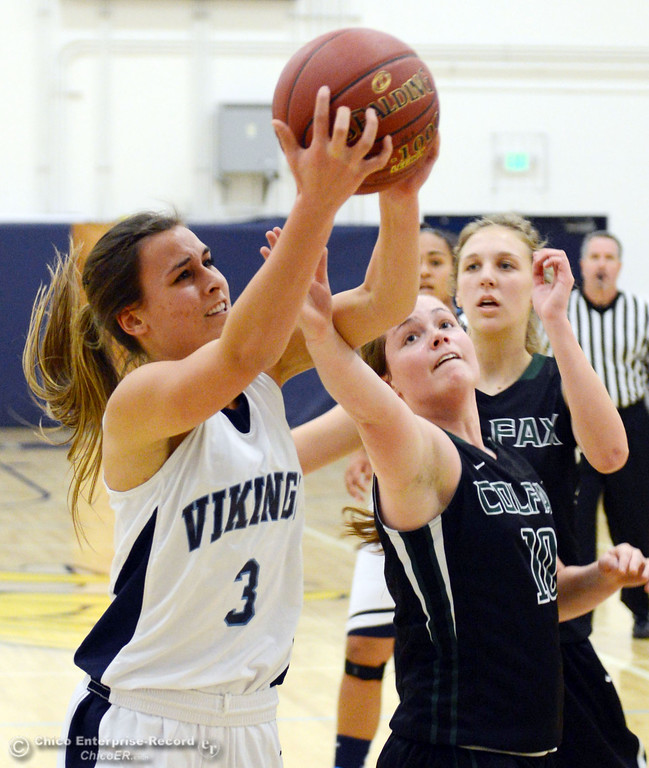 . Pleasant Valley High\'s #3 Izzy Bonacorsi (left) rebounds against Colfax High\'s #10 Taylor Avila (right) in the first quarter of their girls basketball game at PV\'s Varley Gym Saturday, December 7, 2013 in Chico, Calif. (Jason Halley/Chico Enterprise-Record)