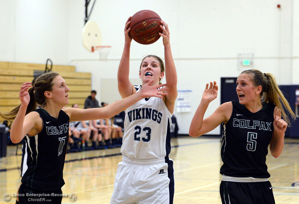 . Pleasant Valley High\'s #23 McKena Barker (center) rebounds against Colfax High\'s #11 Kylee Bauer (left) and #5 Raegan Lillie (right) in the second quarter of their girls basketball game at PV\'s Varley Gym Saturday, December 7, 2013 in Chico, Calif. (Jason Halley/Chico Enterprise-Record)