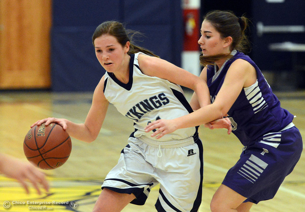 . Pleasant Valley High\'s #11 Kristina Joyce (left) dribbles against Petaluma High\'s #25 Sophia Bihn (right) in the first quarter of their girls basketball game at PVHS Varley Gym Friday, December 6, 2013 in Chico, Calif. (Jason Halley/Chico Enterprise-Record)