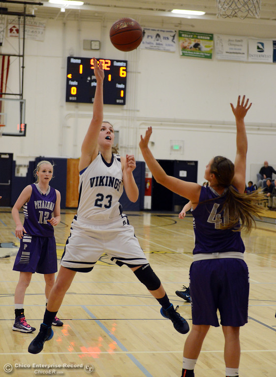 . Pleasant Valley High\'s #23 McKena Barker (left) puts up a shot against Petaluma High\'s #40 Joelle Krist (right) in the first quarter of their girls basketball game at PVHS Varley Gym Friday, December 6, 2013 in Chico, Calif. (Jason Halley/Chico Enterprise-Record)