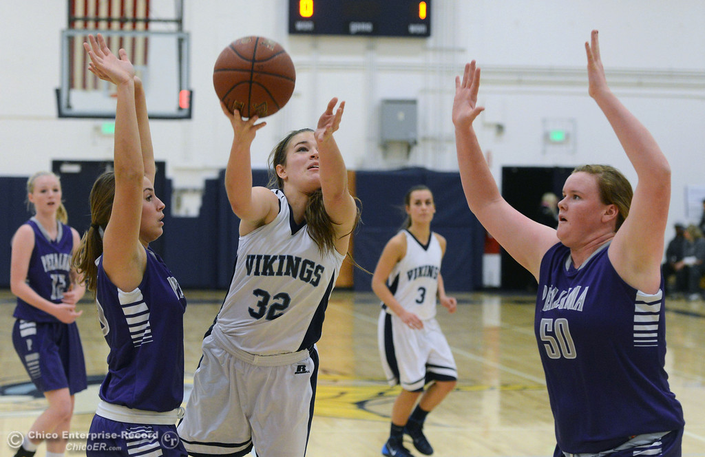 . Pleasant Valley High\'s #32 Natalie Makel (center) goes up for a basket against Petaluma High\'s #40 Joelle Krist (left) and #50 Allison Scranton (right) in the first quarter of their girls basketball game at PVHS Varley Gym Friday, December 6, 2013 in Chico, Calif. (Jason Halley/Chico Enterprise-Record)