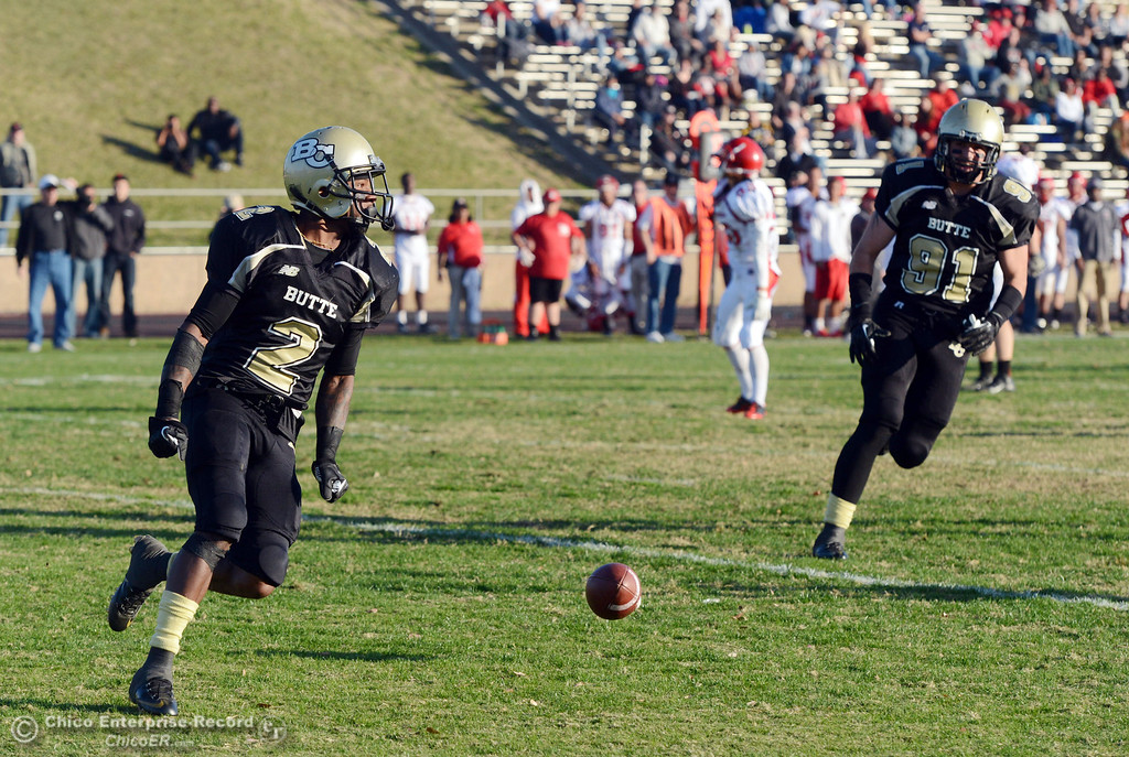 . Butte College\'s #2 Deonte Flemings (left) scores a touchdown on an interception as #91 Mike Fratianni (right) comes to congratulate against City College of San Francisco in the fourth quarter of their football game at Butte\'s Cowan Stadium Saturday, November 16, 2013 in Butte Valley, Calif.  (Jason Halley/Chico Enterprise-Record)