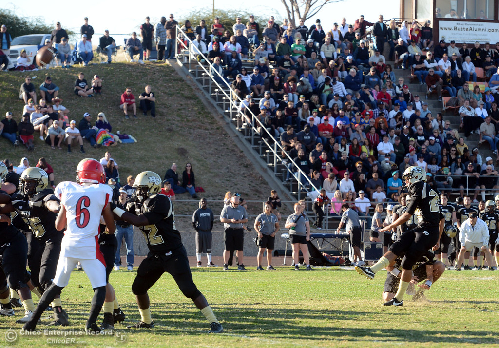 . Butte College\'s #27 Rigoberto Sanchez kicks the extra point against City College of San Francisco in the third quarter of their football game at Butte\'s Cowan Stadium Saturday, November 16, 2013 in Butte Valley, Calif.  (Jason Halley/Chico Enterprise-Record)