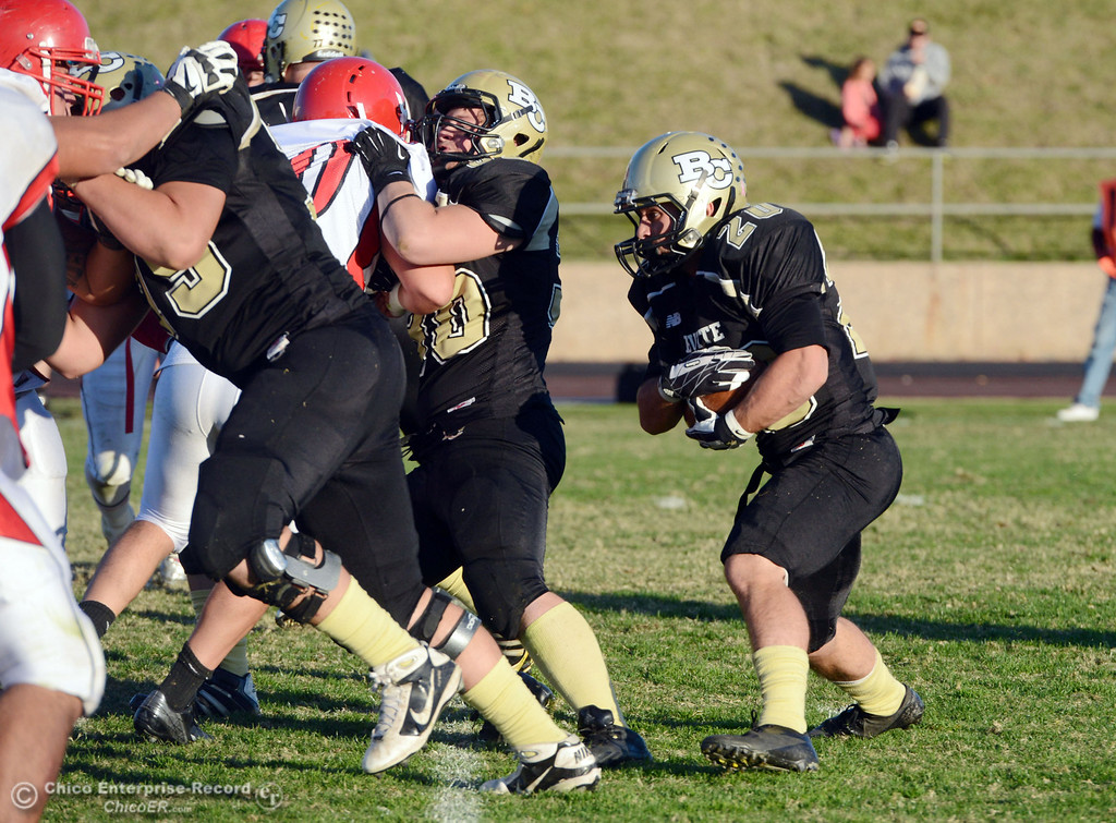 . Butte College\'s #20 Armand Bokitch (right) rushes against City College of San Francisco in the fourth quarter of their football game at Butte\'s Cowan Stadium Saturday, November 16, 2013 in Butte Valley, Calif.  (Jason Halley/Chico Enterprise-Record)
