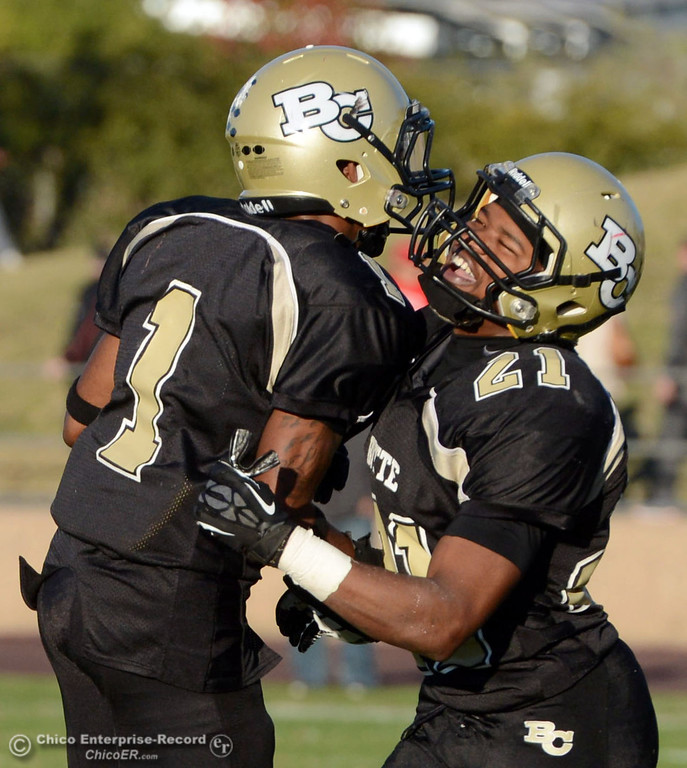 . Butte College\'s #1 Wes McCoy (left) and #21 Marvel Harris (right) celebrate a stop against City College of San Francisco in the fourth quarter of their football game at Butte\'s Cowan Stadium Saturday, November 16, 2013 in Butte Valley, Calif.  (Jason Halley/Chico Enterprise-Record)