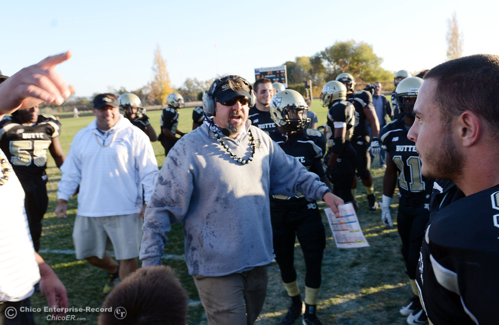 . Butte College coach Jeff Jordan had a bucket of water dumped on him as they win against City College of San Francisco at the end of their football game at Butte\'s Cowan Stadium Saturday, November 16, 2013 in Butte Valley, Calif.  (Jason Halley/Chico Enterprise-Record)