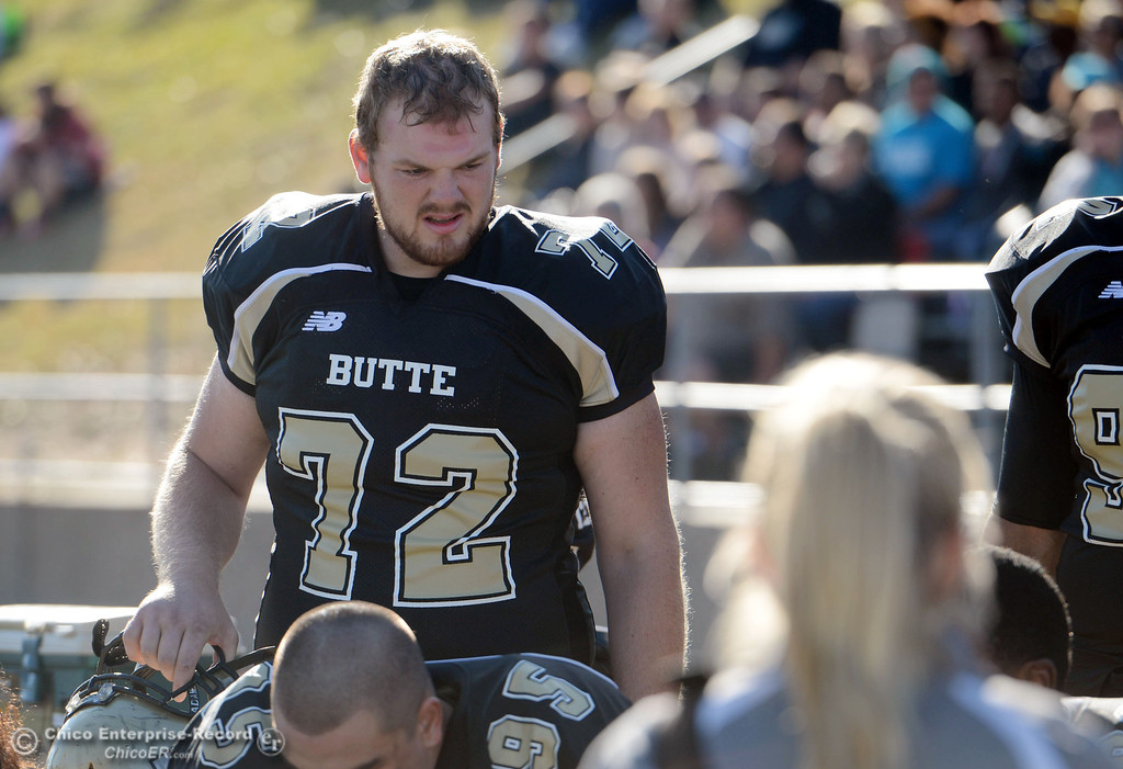 . Butte College\'s #72 Dru Parker looks on from the sidelines against City College of San Francisco in the first quarter of their football game at Butte\'s Cowan Stadium Saturday, November 16, 2013 in Butte Valley, Calif.  (Jason Halley/Chico Enterprise-Record)