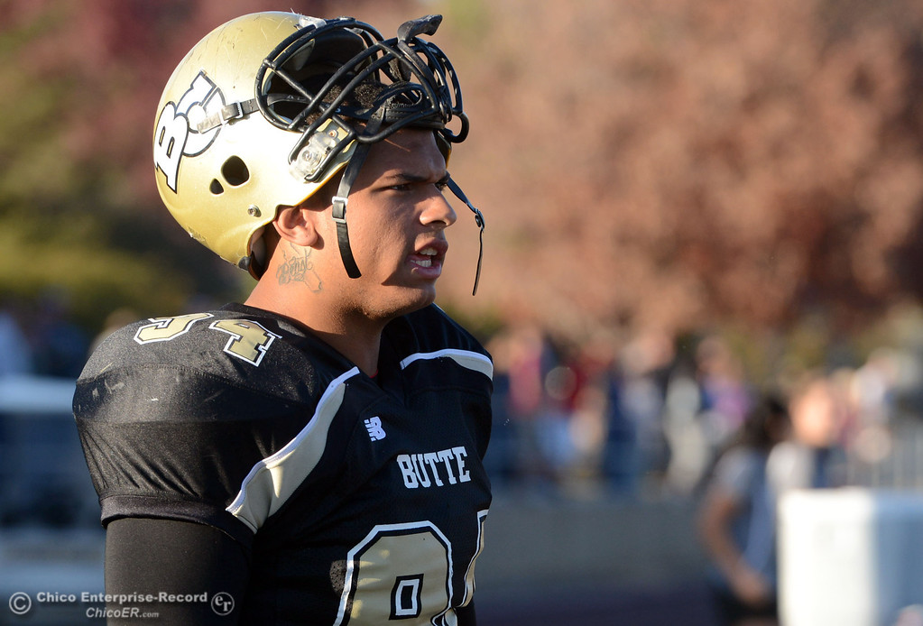 . Butte College\'s #94 Shannon Dinsdale looks on against City College of San Francisco in the fourth quarter of their football game at Butte\'s Cowan Stadium Saturday, November 16, 2013 in Butte Valley, Calif.  (Jason Halley/Chico Enterprise-Record)