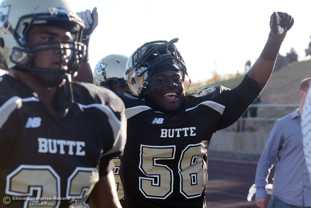 . Butte College\'s #58 Sie Doe Jr. begins to celebrate against City College of San Francisco in the fourth quarter of their football game at Butte\'s Cowan Stadium Saturday, November 16, 2013 in Butte Valley, Calif.  (Jason Halley/Chico Enterprise-Record)