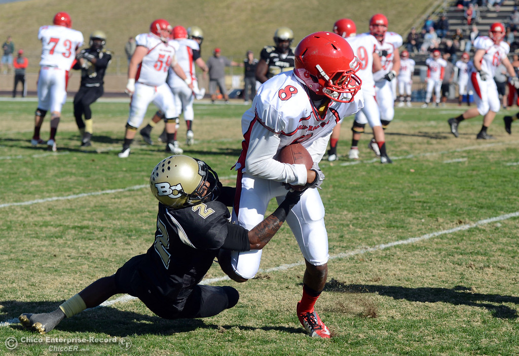 . Butte College\'s #2 Deonte Flemings (left) tackles against City College of San Francisco\'s #8 Xavier Amey (right) in the first quarter of their football game at Butte\'s Cowan Stadium Saturday, November 16, 2013 in Butte Valley, Calif.  (Jason Halley/Chico Enterprise-Record)