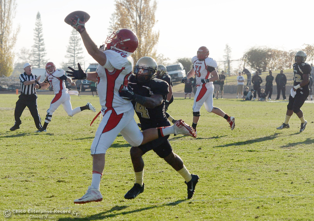 . City College of San Francisco\'s #86 Ryan Virgin (left) catches against Butte College\'s #4 Chris Edwards (right) in the third quarter of their football game at Butte\'s Cowan Stadium Saturday, November 16, 2013 in Butte Valley, Calif.  (Jason Halley/Chico Enterprise-Record)