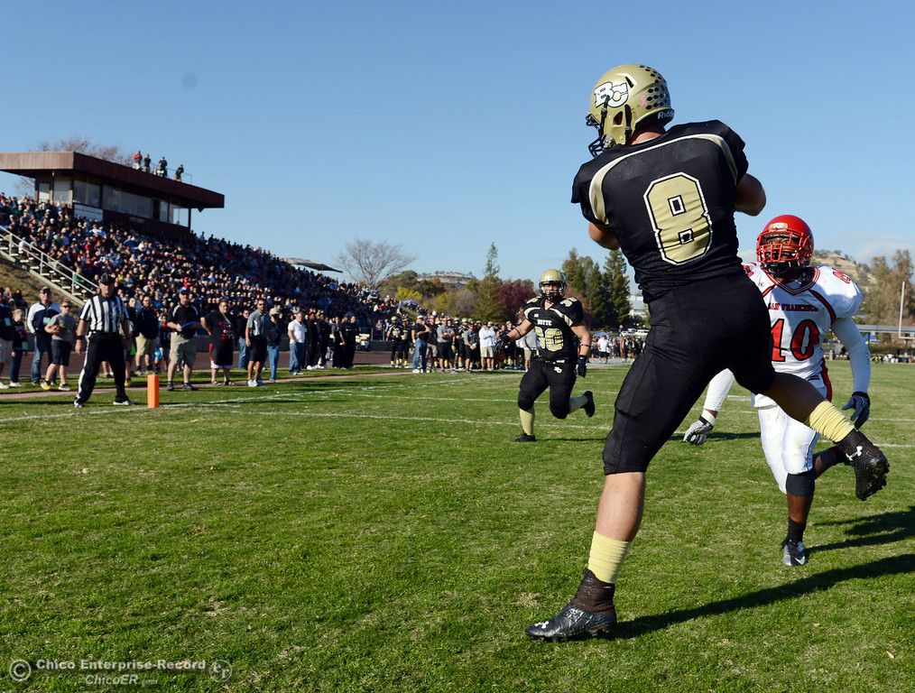 . Butte College\'s #8 Bo Brummel (left) catches for a touchdown against City College of San Francisco\'s #10 Nicholas Holt (right) in the second quarter of their football game at Butte\'s Cowan Stadium Saturday, November 16, 2013 in Butte Valley, Calif.  (Jason Halley/Chico Enterprise-Record)
