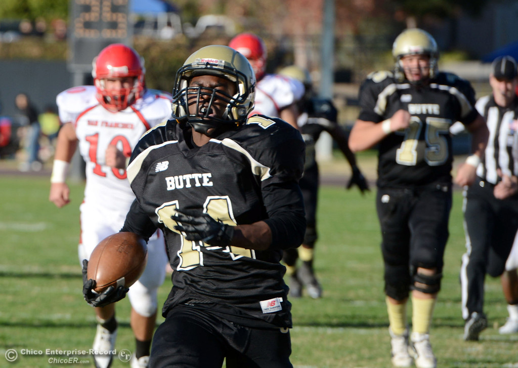 . Butte College\'s #14 Robert Frazier rushes against City College of San Francisco in the third quarter of their football game at Butte\'s Cowan Stadium Saturday, November 16, 2013 in Butte Valley, Calif.  (Jason Halley/Chico Enterprise-Record)