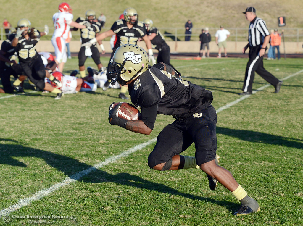 . Butte College\'s #2 Deonte Flemings intercepts a pass on a 2pt conversion attempt to run it back to the end zone and score 2  against City College of San Francisco in the fourth quarter of their football game at Butte\'s Cowan Stadium Saturday, November 16, 2013 in Butte Valley, Calif.  (Jason Halley/Chico Enterprise-Record)